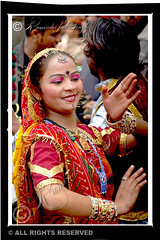 Folk Dancer - Amritsar (Raminder Pal Singh) Tags: woman india color colors girl beautiful beauty smile vertical eyes hands women artist d70 nikond70 dancer move posture perform punjab folkdance amritsar rajasthan visage lively bangles raminder 50millionmissing