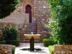 The Alcazaba of Malaga (Steve-h) Tags: water fountain stone gardens spain bricks steps doorway finepix fujifilm walls bushes malaga alcazaba hedges moslem steveh eightpointedstar s9600 photofaceoffwinner theperfectphotographer 11thcenturypalacefortress