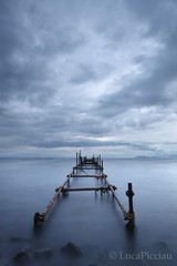 Walk into nothing (LucaPicciau) Tags: sky seascape cold wet water misty night clouds canon landscape evening coast pond long mare quiet nuvola cloudy walk secret foggy cielo ethereal horror serene nothing void acqua molo placid damp sera endless ruggine ferro passerella nuvoloso vuoto tenebre niente novole mistico picciau lucapicciau notteperspective