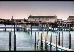 Boats Needed (Craig - S) Tags: light lighthouse ferry marina docks island pier dock michigan arnold warehouse transit beacon hdr mackinac supershot sterkorama waitingforthecrowdstoarrive