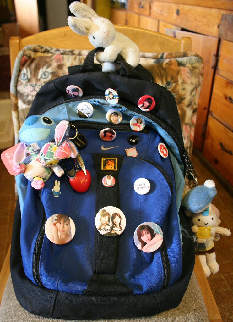 Hopper atop backpack