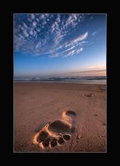 Been there (Garry - www.visionandimagination.com) Tags: travel beach clouds sunrise foot sand pacific oz australia wideangle pacificocean 5d shield australien aus australis soe footprint garry eastcoast australie excellence novideo xmaspresent outstandingshots mywinners abigfave  ef1635mm 5d365 megashot bestofaustralia overtheexcellence fiveflickrfavs lastminutexmas visionandimagination wwwvisionandimaginationcom