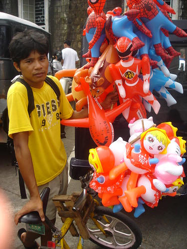 Tiwi, Albay toy vendor, inflatables, bike, bicycle, street boy  Buhay Pinoy Philippines Filipino Pilipino  people pictures photos life Philippinen  菲律宾  菲律賓  필리핀(공화국)  balloon