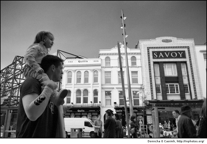 Girl on dad's shoulders