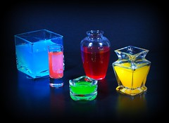 Glass and Lighting (floralgal) Tags: lighting stilllife color glass bright artistic creative shapes glowing liquid goldstar blueribbon fpc boldcolors glasscontainers platinumphoto glassshapes theperfectphotographer goldstaraward coloredliquid glasswithcoloredliquid