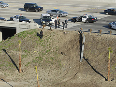 The SUV thief drove down this embankment. (Photo courtesy of The Orange County Register)