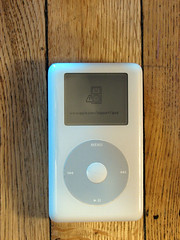broken iPod (glenn~) Tags: pictures wood original music white broken wheel fix menu drive support portable media ipod play floor photos hard itunes icon mp3 player click trick pause clickwheel scroll 2007 volume sadface notworking scrolling wwwapplecom nexttrack previoustrack