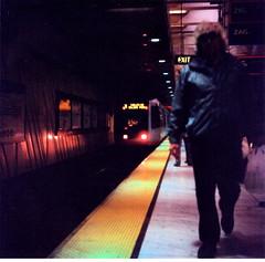 San Francisco commute (Leonard Tsang) Tags: sanfrancisco ca 120 film muni squareformat sanfranciscobayarea embarcadero leisure yashicad agfaportrait160