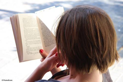 woman_reading_a_book_in_hand-other