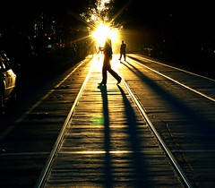 walking with the saints (mugley) Tags: street people prime nikon shadows d70 hill silhouettes australia melbourne victoria f16 pedestrians cropped rays nikkor goldenhour lowsun bourkest tramtracks 50mmf14d melbflickrnovember2007