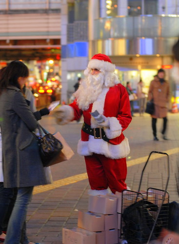 Santa giving out evangelistic Christmas carols at Shibuya Crossing