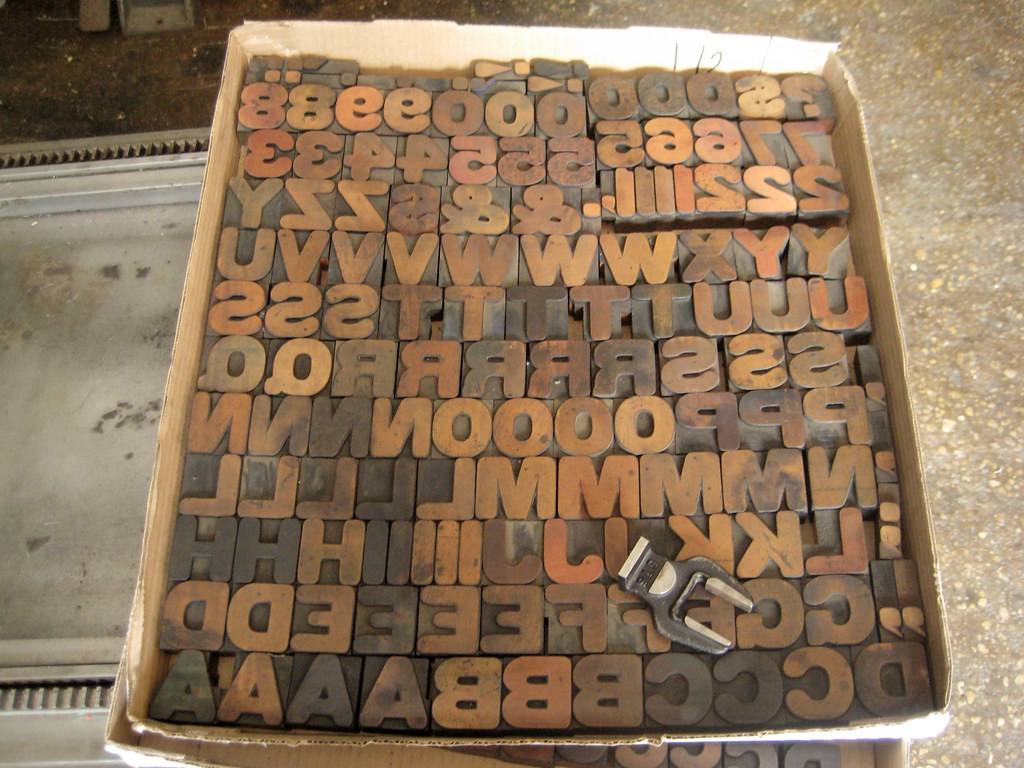 Pizza box full of wood type for Cooper Union