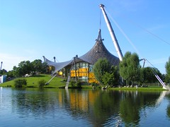 Olympic Park in Munich, Bavaria, Germany (UweBKK ( 550 on )) Tags: park summer urban sun lake reflection building water architecture germany munich bayern deutschland bavaria minolta konica olympic dimage z1 olympiapark thegalaxy photographyrocks golddragon allxpressus unlimitedphotos arealgem oneofmypics platinumpeaceaward rememberthatmoment rememberthatmomentlevel1