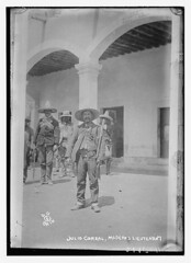 Julio Corral, Madero's lieutenant.  (LOC) (The Library of Congress) Tags: street blackandwhite bw blancoynegro america vintage noiretblanc rifle patio sw libraryofcongress sombrero 1910s schwarzweis biancoenero hacienda bandolier casagrande 3030 mexicanrevolution car