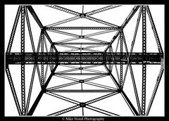 High Level Bridge (Mike Wood Photography) Tags: trip bridge vacation bw vertical grid eos iron exploring angles rail lookingup alberta arr underneath lethbridge allrightsreserved highlevelbridge tressle mikewood built1909 400d betterthangood mikewoodphotographycom mikewoodphotography 314fthigh 5327ftlong mwptrav