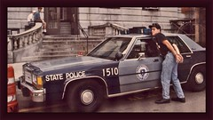 Drew Beechum and State Police Car at Beacon Hill (Kevin Borland) Tags: autumn usa fall car boston automobile unitedstates massachusetts newengland policecar northamerica northeast beaconhill massachusettsstatepolice northeasternunitedstates drewbeechum