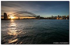 Sydney Harbour Bridge At Sunset (Sam Ili) Tags: bridge light sunset sea sky sun house building silhouette architecture clouds canon opera harbour sydney australia dri hdr photomatix explored 450d canon1022mm3545