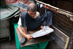 Acrobat Reader - Macau (Maciej Dakowicz) Tags: china travel man tourism reading newspaper asia reader read acrobat macau oldcity sar portugese acrobatreader lpreading
