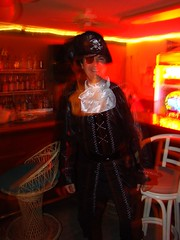 Listing to starboard (mckenzieo) Tags: party black halloween hat bar night costume nightshot bottles interior ascot liquor neonsign ceilingfan eyepatch barstool skullandcrossbones swashbuckler pensacolafl floridapanhandle northwestflorida losingface loseface lostface mckenzieoerting purplehairedchick mckenzieo mckenzieocom pensacolabeachyachtclub