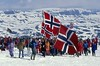 A group of Norwgians wave flags and show their pride at Finse, Norway