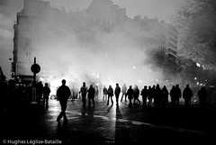 (Hughes Léglise-Bataille) Tags: blackandwhite bw paris france topf25 silhouette backlight topf50 noiretblanc protest photojournalism demonstration flare manif manifestation 2007 fumigene fonctionnaires