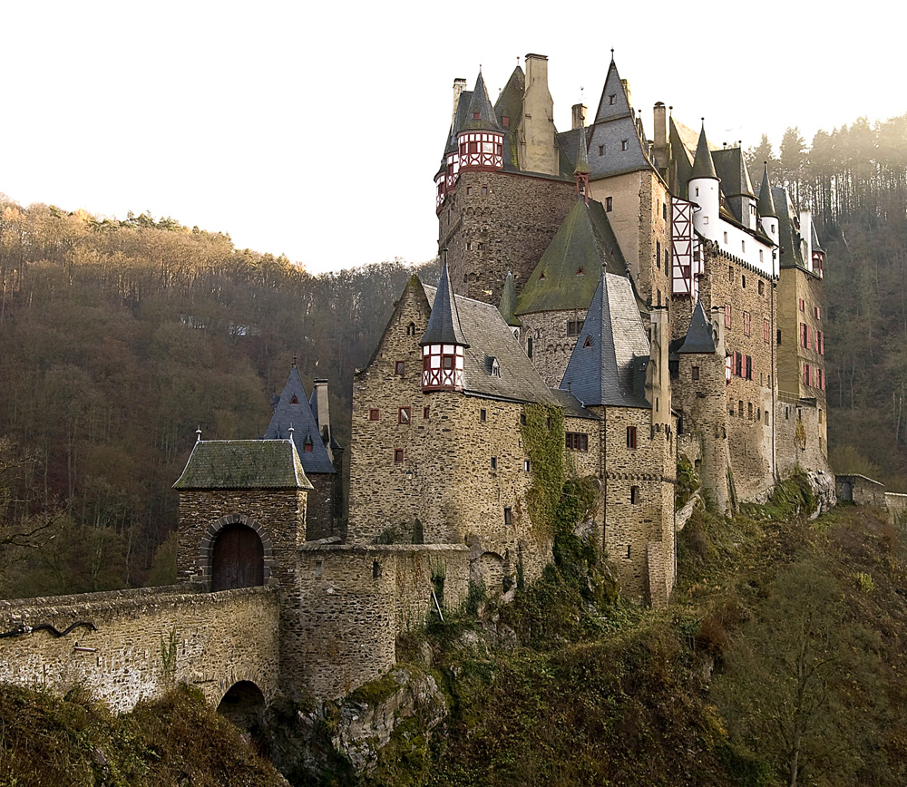 Eltz Castle is a medieval castle nestled in the hills above the Moselle River between Koblenz and Trier, Germany. It is still owned by a branch of the same family that lived there in the 12th century, 33 generations ago.