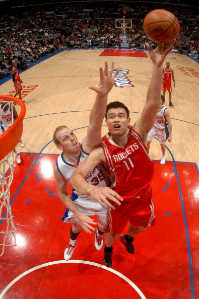 Yao Ming shoots a jump hook over LA Clipper Chris Kaman on Monday, November 26th in Los Angeles in an 88-71 Rockets win.  Yao finished with 14 points on 5-of-11 shooting, 8 rebounds and 1 block.  Meanwhile, Kaman came out strong and scored 22 points on 7-of-20 shooting, and 13 boards.