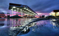 Gas Station Sunset 12.21.2007 (Notley) Tags: winter sunset snow reflection ice water night lights highway december gas gasstation truckstop missouri freeze callawaycounty reflexion i70 reflexin 2007 gasolinera interstate70 10thavenue odraz kingdomcity distributoredibenzina postodegasolina notley ruralphotography eftertanke notleyhawkins missouriphotography stationdegaz httpwwwnotleyhawkinscom notleyhawkinsphotography