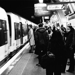 Paris (Peter Gutierrez) Tags: light shadow urban blackandwhite bw white black paris france film public train underground subway square french la photo europe european shadows metro transport tube grain rail railway passengers peter commute gutierrez commuter format passenger metropolitain grainy mass metropolitan franais commuters urbain shadowed shadowy parisienne parisien franaise parisiens parisiennes favemegroup6 petergutierrez