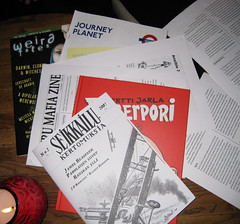 A small stack of fanzines on the table