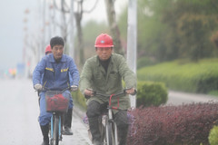 Common Sense (Barry Zee) Tags: china hardhat rain bicycle traffic police prc nanjing obvious efficiency peoplerepublicofchina savetime