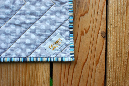 grey & gold baby quilt label