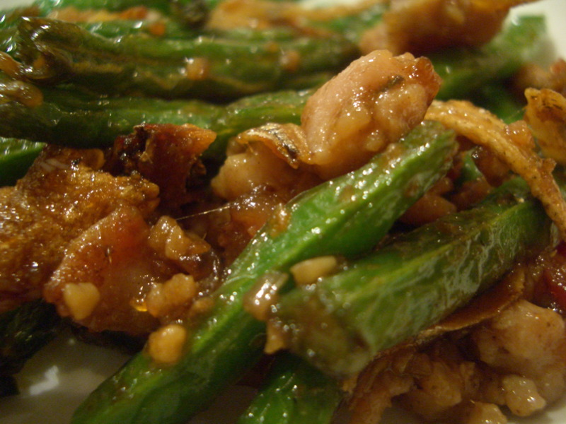 Pork and beans with whitebait (closeup)