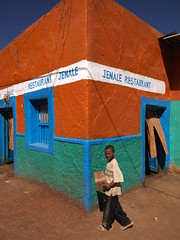 Boy in front of a colourful restaurant in Babile, Ethiopia (Eric Lafforgue) Tags: africa people smiling vertical photography restaurant day child african ethiopia multicolored oneperson hornofafrica eastafrica vibrantcolor colorimage ruralscene oromia traveldestination 89years a700996