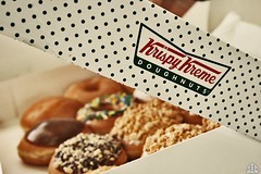 krispy kreme (FatoOoma Qatar ~) Tags: camera food white macro closeup canon logo photo yummy focus flickr day colours image time sweet chocolate picture tasty krispykreme explore sprinkles fav 2008 doughnuts krispy thebest fatma kreme doha qatar intersting browen 30fav flickcom 20fav 400d fatoooma