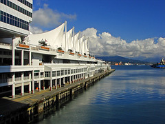 The Canada Place in Vancouver, BC, Canada (Ann Badjura Photography) Tags: ocean city light plants canada mountains nature water skyline architecture modern vancouver clouds buildings reflections landscape coast scenery pacific path landmark inlet