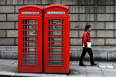 Three reds (rmtx) Tags: city uk red two people urban brown white man black yellow stone wall wednesday walking concrete person photography grey one graffiti scotland three edinburgh phone image box pavement stones telephone stickers may icon dirty explore jacket photograph papers paving crown british 2008 iconic folder bt telephonebox gpo slabs pluralism midlothian georgeivbridge safetyinnumbers