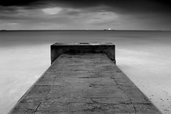 Temple of the sea (~Glen B~) Tags: longexposure sea sky bw white black beach clouds dark concrete dusk ships shore thingy redcar tideline redbubble:id=16537052templeofthesea