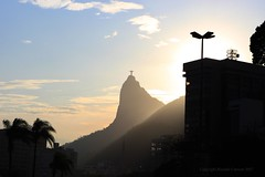 1,000 - Cristo Redentor over Rio (Ricardo Carreon) Tags: trees sunset sky sun silhouette rio brasil riodejaneiro buildings rj thankyou gracias obrigado cristoredentor christtheredeemer corcovado explore views feed soe 1000 challengeyouwinner abigfave aplusphoto superlativas explore05november2007