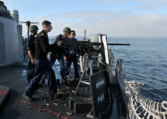 Ship captain fires a .50-caliber machine gun during a pre-action calibration fire. (Official U.S. Navy Imagery) Tags: navy sailor usnavy machinegun commandingofficer guidedmissilefrigate 50caliber ussthachffg43 cmdrjeffreyscudder