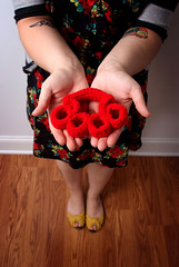 Crochet Brass Knuckles (Hustle and Sew) Tags: red floral tattoo fight crochet yarn weapon knuckles brassknuckles knucks knuckledusters