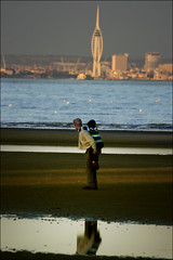 Over there (#3) The Spinnaker Tower from Appley sands (s0ulsurfing) Tags: s0ulsurfing 2007 isleofwight isle wight island vectis appleysands appley beach coast coastal coastline sea water ocean shore shoreline seascape ryde lowtide spinnakertower portsmouth candid people humans dof blur bokeh focus sunset sun sundown dusk evening twilight parent parenting father dad play piggyback ride riding carry carrying reflection vertical eow