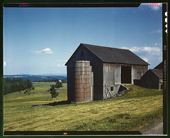 Farmland in the Catskill country, in New York State  (LOC) (The Library of Congress) Tags: wood trees usa ny newyork green field grass june clouds barn rural vintage collier landscape rust kodak farm bluesky upstateny slidefilm structure silo domestic 1940s pasture transparency weathered 4x5 lf libraryofcongress catskills ferme largeformat woodenbuilding 1943 1913 fsa catskill transparencies greengrass outbuildings pastorallandscape maisonenbois johncollier xmlns:dc=httppurlorgdcelements11 paysagedecampagne bankbarn dc:identifier=httphdllocgovlocpnpfsac1a34567 pastoralview agriculter