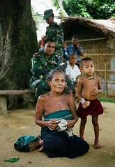 War & Peace (2) (janchan) Tags: poverty portrait film army 50mm war asia peace child retrato burma documentary soldiers guns oldlady myanmar ethnic ritratto bangladesh reportage povertà pobreza bambino marma fuji160npc chittagonghilltracts whitetaraproductions