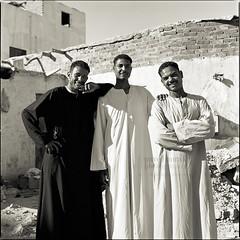 Threesome (Vincént) Tags: life travelling 6x6 smiling zeiss egypt streetphotography documentary hasselblad squareformat threesome orient natives threemen vincentvega 500cm ilfordid11 fujineopanacros100 ilfordrapidfixer nikonsupercoolscan9000ed planar8028t pavelhorák wwwpavelhorakcom