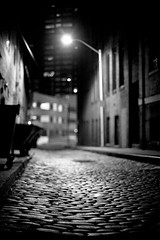 Cobble (patrickjoust) Tags: street city light summer urban bw usa white black blancoynegro lamp stone night america canon lens eos 50mm prime us alley focus flickr bokeh united towers patrick maryland charles baltimore mount cobble 5d states manual nikkor 50 joust vernon ai biancoenero morton blancinegre f12 estados blancetnoir unidos schwarzundweiss 50mmf12ai lovelycity cityskip patrickjoust
