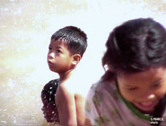 Phnom Penh. Is it possible that bathing in the Mekong River brings illumination and bliss? (gilmarcil) Tags: boy girl kids river children cambodge cambodia child joy chi ho enfant minh fille gilles mekong joie garçon marcil kampuchea 5photosaday colourartaward gillesmarcil