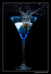 Splashed, Not Stirred! (Fraggle Red) Tags: blue red black green glass raw flash olive martini vodka martiniglass splash blueglass freezemotion supershot canonefs1785mmf456isusm avision adobelighroom canonspeedlite420ex diamondclassphotographer flickrdiamond diamondclassphotographr betterthangood theperfectphotographer winnerheartsawardgroup1stplaceinbeveragescontest