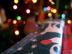 Christmas from the present's perspective (kevin dooley) Tags: christmas xmas red favorite white blur color macro green beautiful wow lights interesting fantastic colorful flickr pretty dof very bokeh box good gorgeous awesome perspective award superior wrapped super christmastree best explore most gift presents winner stunning excellent colored much incredible package breathtaking exciting christmaspresents wrappingpaper phenomenal aplusphoto