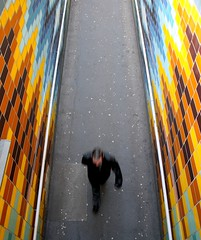 Colour Tunnel and Gum - Elephant and Castle, London (greenwood100) Tags: street city blue urban orange man motion london yellow trash gum hair underpass underground walking subway foot march photo movement arm head mosaic tube blurred litter tiles handrail chewinggum moment capture northern newington southlondon southwark blackjacket se1 lcc bakerloo stride elephantandcastle wrigleys se17 flickrtunity